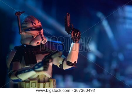 MAY 15 2020:  clone Captain Rex from Star Wars The Clone Wars with blasters drawn in enemy territory - Hasbro action figure
