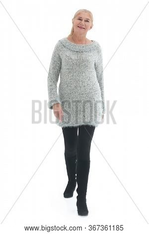 Woman walking towards the camera isolated over a white background