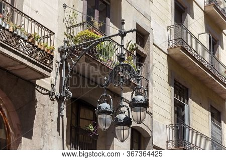 Old Vintage Streetlight In Facade Of The One Of The Historical Buildings In Center Of Barcelona. Spa