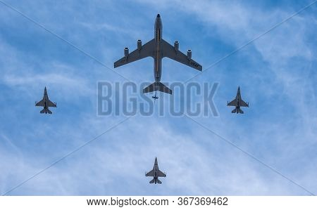 Air Force F16 Jets And Fuel Tanker Flying Overhead In Formation