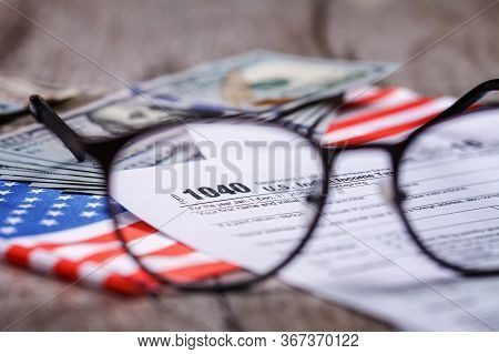 Income Tax With Instruction, Money, Calculator And Glasses. Tax Payment And Filing Concept
