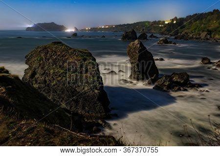Moonlit Night Image Of A Rocky Beach, Northern California Coast