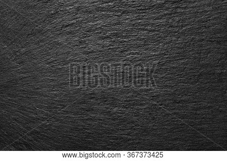 Black Slate Background. Black Stone Slate Board. The Texture Of The Stone. Empty Surface.