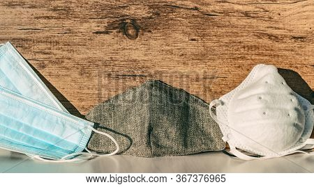 Types of masks for Coronavirus mask wearing: Different PPE protection for COVID-19 : reusable homemade cloth wear, disposable medical mask, n95 respirator for healthcare workers banner background.