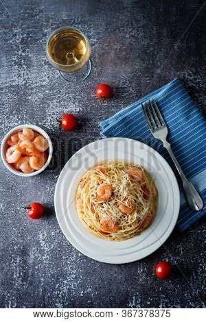 Garlic Shrimp Pasta In White Plate With Glass Of Wine