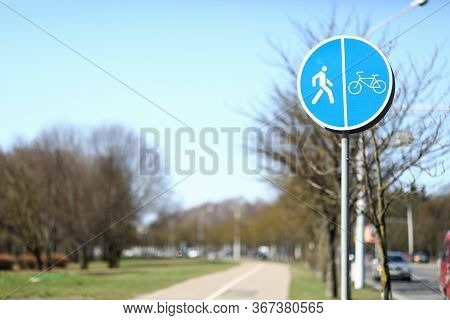 There Sign For Pedestrians And Cyclists On Street. Sign Pedestrian And Bicycle Lane With Traffic Sep