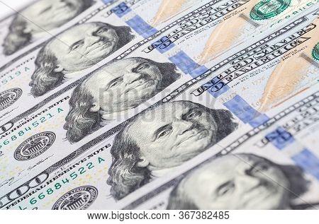 Background Of 100 Dollar Bills. A Pile Of One Hundred Us Dollars - Banknotes. Cash Of Hundred Dollar