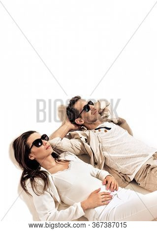 Young romantic couple wearing sunglasses