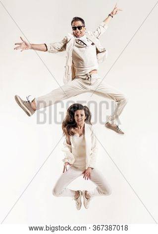 Funny photo of a man jumping over his girlfriend