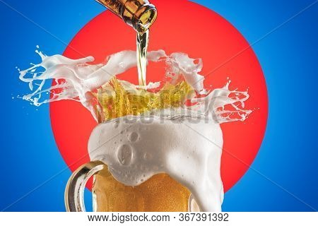 Creative Collage Of Beer Glass With Beer Splashes And Overflowing Foam On Bright Red And Vivid Blue