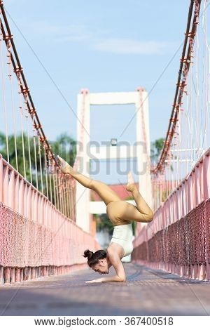 Bridge Pose Sporty Women Doing Warming Up Exercise For Spine, Handstand, Arching Stretching Her Back