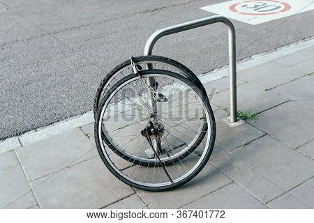May 09, 2020. Krakow, Poland. Bike Wheels With Padlock. Theft Of A Bicycle. Bicycles Stolen And Left