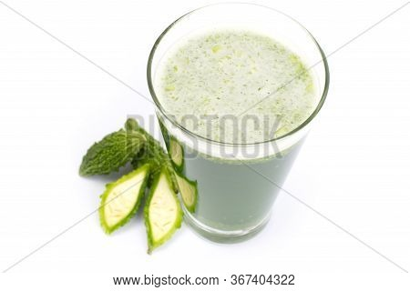 Herbal Juice With Bitter Melon Or Bitter Gourd Isolated On White Background.