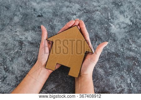 Property Or Insurance, Hand Holding House Icon Next To Text
