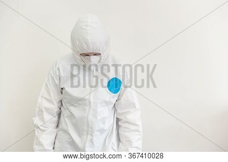 Front View Of Doctor Lowering Her Head From The Desolation Of The Coronavirus Pandemic, With Gloves,