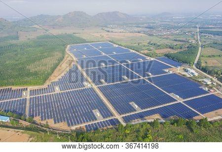 Solar Cell Energy Farm. High Angle View Of Solar Panels On An Energy Farm. Full Frame Background Tex
