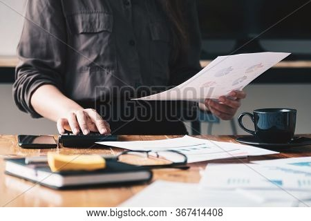 Close Up View Of Bookkeeper Or Financial Inspector Hands Making Report,