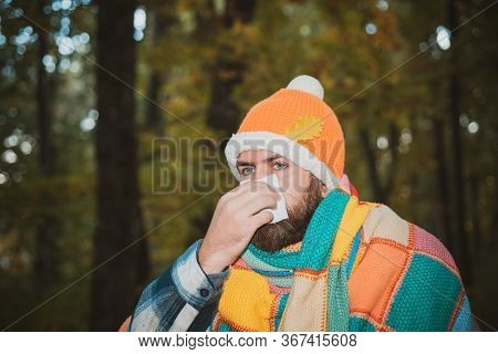 Bearded Man Sneezing And Coughing. Sick Guy Catch Cold. Sick Boy At Cold Forest Wrapped In Blanket S