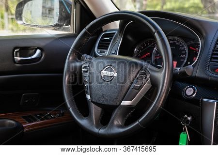 Novosibirsk/ Russia - May 03 2020: Nissan Teana,auto Interior: Steering Wheel With Red Logo And  Spe