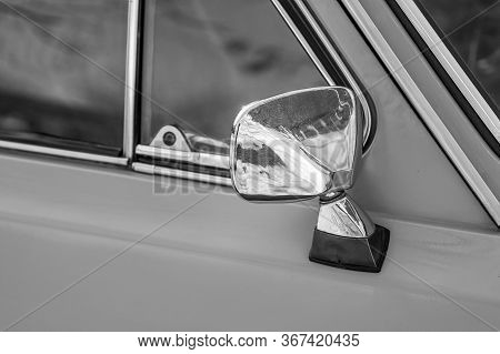 Rarity Classic Car Mirror. Monochrome Old Style Photo.