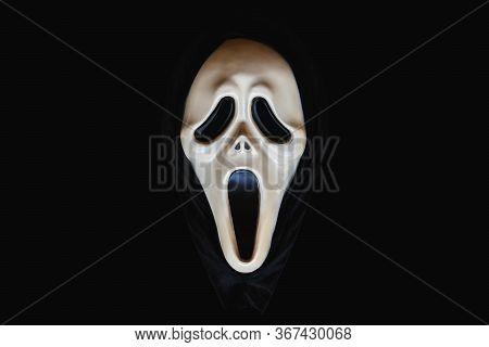 Bangkok, Thailand, 26 Jan 2020: Close-up Of Screaming Carnival Mask Object On A Black Background