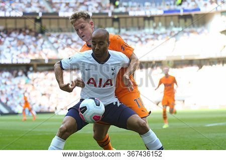 London, England - August 25, 2019: Lucas Moura Of Tottenham And Matt Ritchie Of Newcastle Pictured D