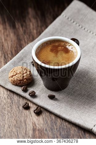 Cup Of Coffee With Amaretti (italian Biscuits) On Rustic Wooden Background.