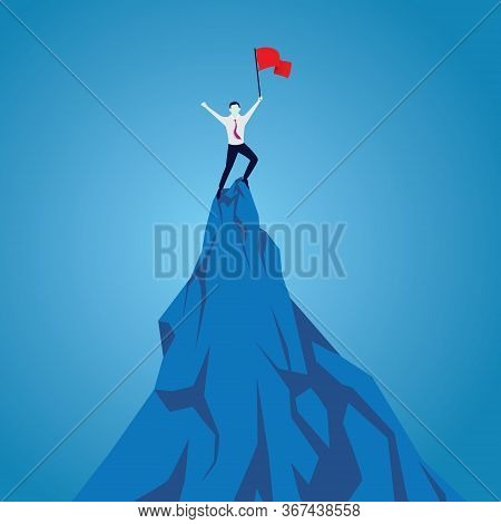 Businessman Celebrating Achievement, Standing On Top Of Mountain With Flag In Hand.purpose Concept.