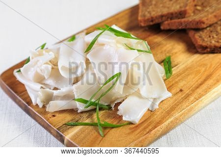 Salty Salo On A Wooden Table Salty Lard On A White Plate, Ukrainian Cuisine