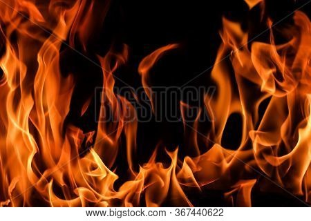 Flames Of Fire On A Black Background. The Mystery Of Fire.