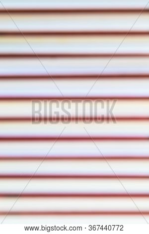 Unfocused Shelves With Book. Abstract Blured Bookshelves With Books. Defocused Background From Many