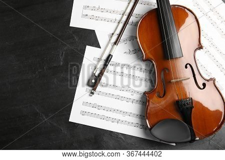 Violin, Bow And Note Sheets On Stone Table, Flat Lay