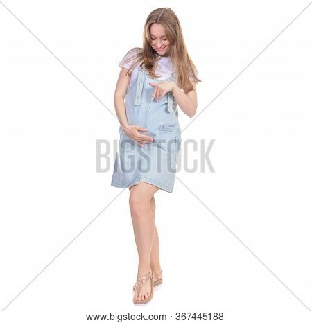 Pregnant Woman In Denim Sundress Standing Looking Smiling On White Background Isolation