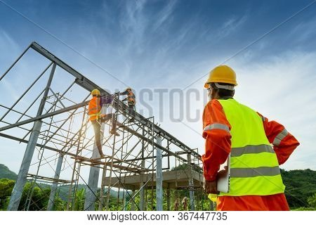 Engineer Technician Watching Team Of Workers On High Steel Platform, Engineer Technician Constructio