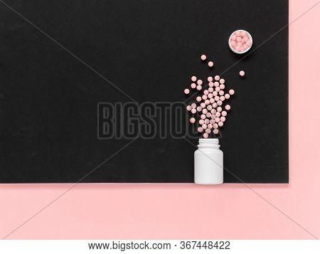 Vitamins. Antiviral Drug Tablets. Antidepressants. Round Pink Healthy Pills And Pill Bottle On Black