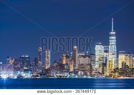 New York,usa, 08-25-17: New York City Skyline  At Night With Reflection In Hudson River.