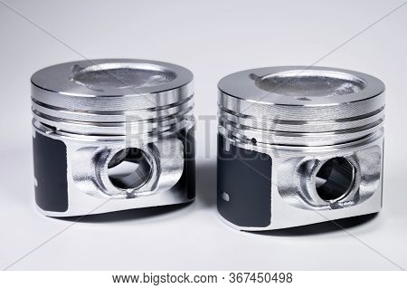 Close-up Of Two New Internal Combustion Engine Piston On A Gray Gradient Background. The Concept Of