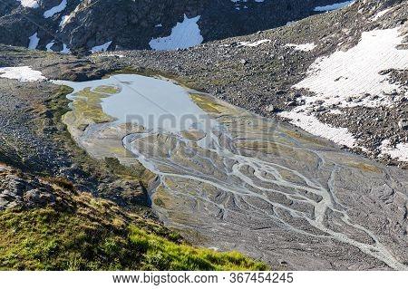 Dry Mountain River Flowing Brook In Wittenwasseren, Swiss Alps