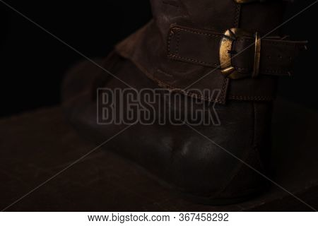 Close Up View Of Medieval Scottish Brown Leather Shoes With Buckle