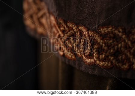 Close Up View Of Medieval Scottish Brown Clothing With Embroidery