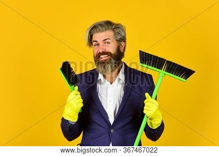 Clear Business. Mature Male Worker With Broom Cleaning. Male Janitor Clean With Broom. Businessman C