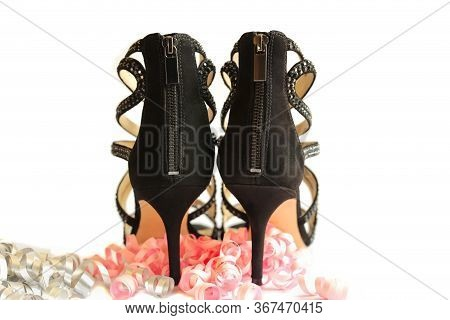 Pair Of Black High Heels Shoes With Pink Party Streamers. Woman Shoes Isolated On The White Backgrou