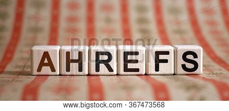 Ahrefs - Text Concept On Wooden Cubes On A Striped Bright Background