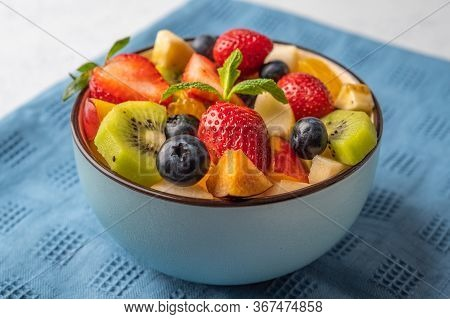 Fresh Fruit Salad With Different Ingredients On Linen Napkin. Healthy Diet. Close Up