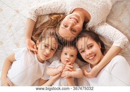 Happy Mom With Her Cheerful Children. The Top Shot. Happiness In The Family