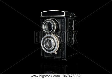 One Whole Vintage Camera Two Lens Isolated On Black Glass