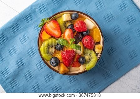 Fresh Fruit Salad With Different Ingredients On Linen Napkin. Healthy Diet. Top View