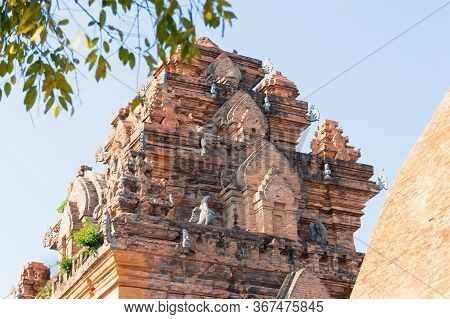 Red Brick Sculptures At The Top Of An Ancient Tower Of Cham Culture