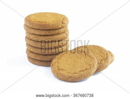 Close Up Plie Of Ginger Biscuits With More Behind   Isolated On A White Background