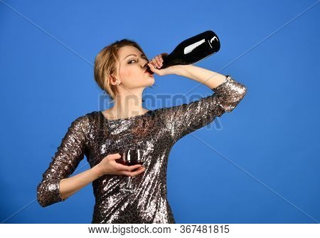 Girl With Serious Face Drinks Expensive Cabernet Or Merlot